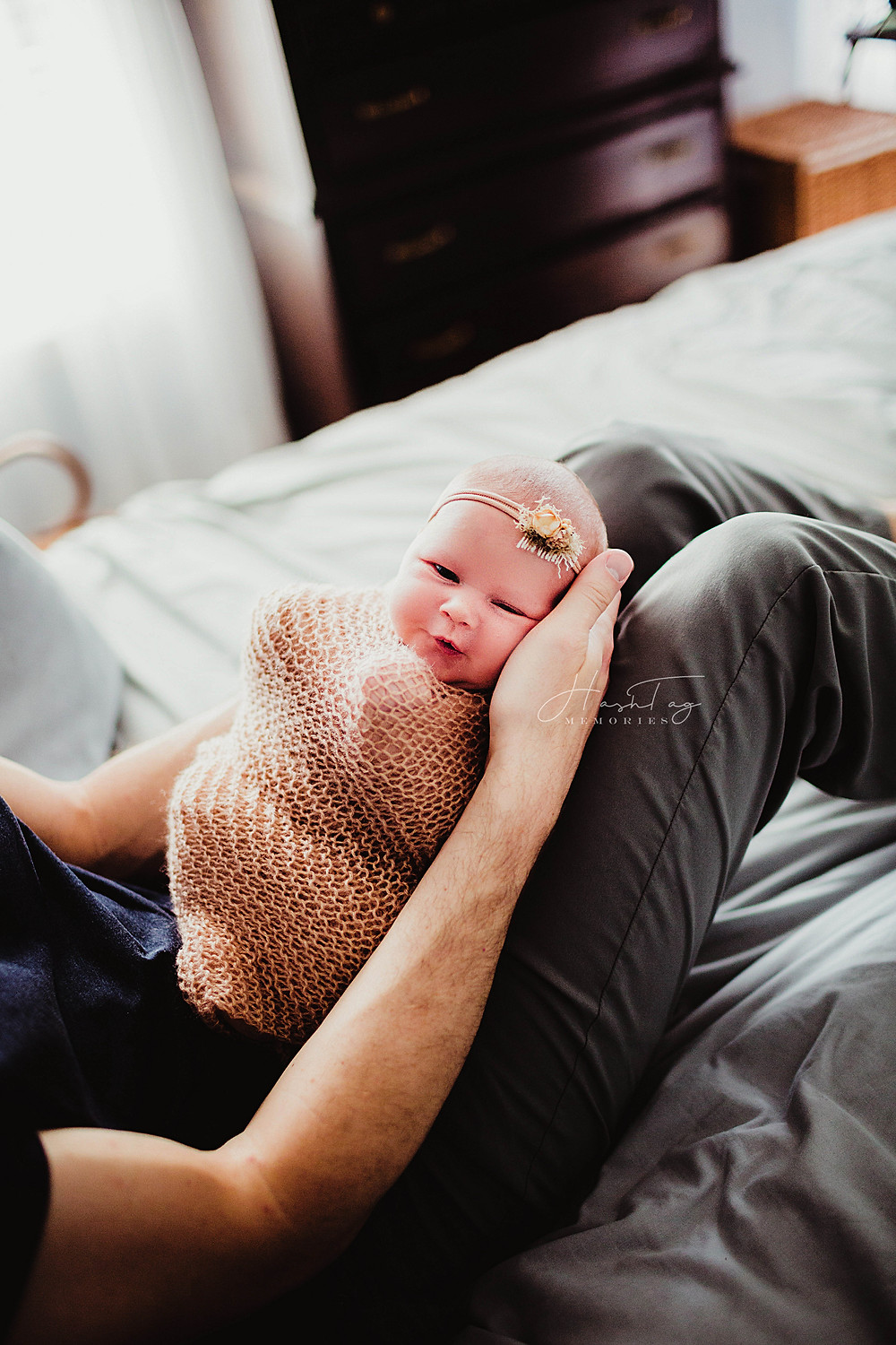 baby girl in dad's lap, pink baby headband, newborn baby, at home newborn photography