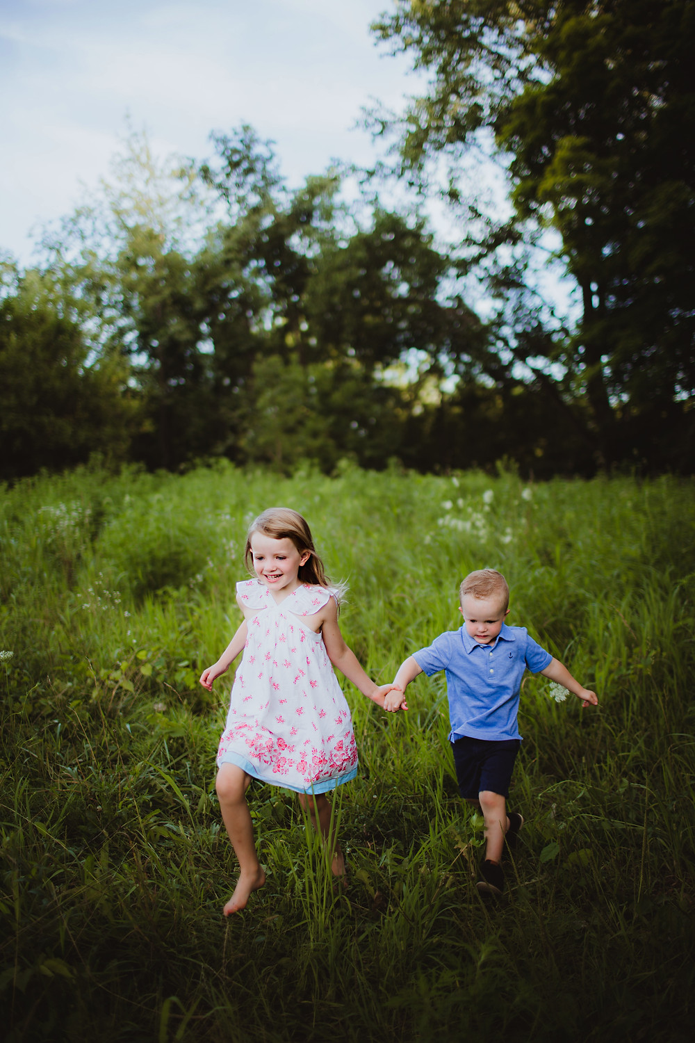 brother and sister playing in Noblesville, Indiana field during family photos