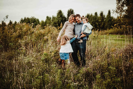 central indiana family photographer, couple snuggles in field in noblesville boho fall photo shoot