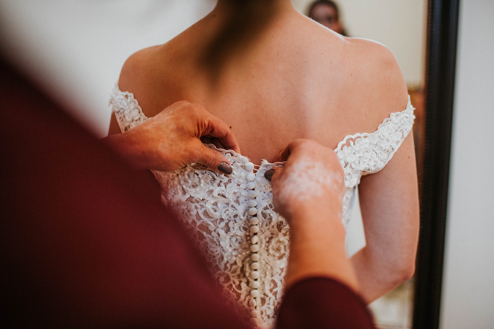 lace wedding dress with buttons shot by hashtag memories photography