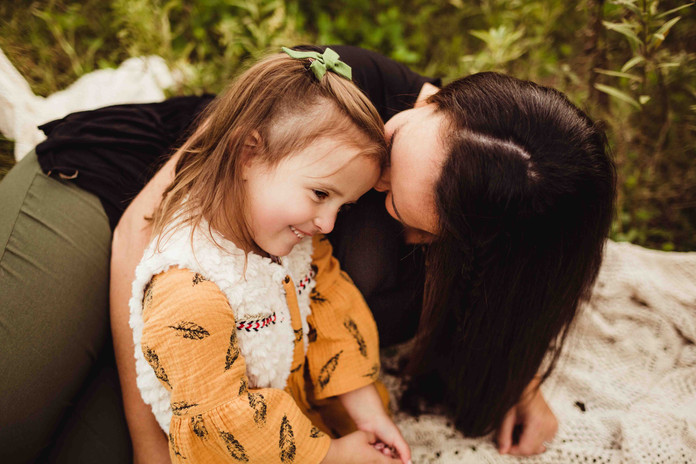 noblesville family photos in fall with mom and toddler snuggling
