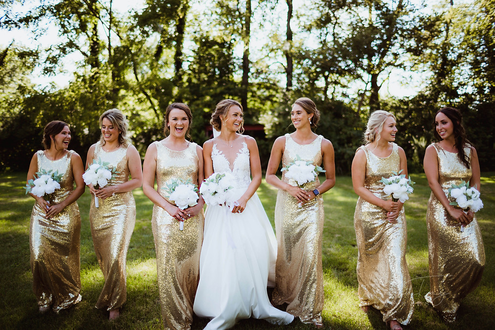 bridesmaids in gold bridesmaids dresses, bride in tattoo lace at Indianapolis wedding venue