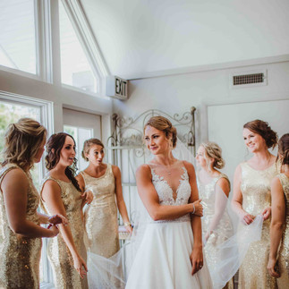 bride gets ready in bridal suite at the loft on isanogle