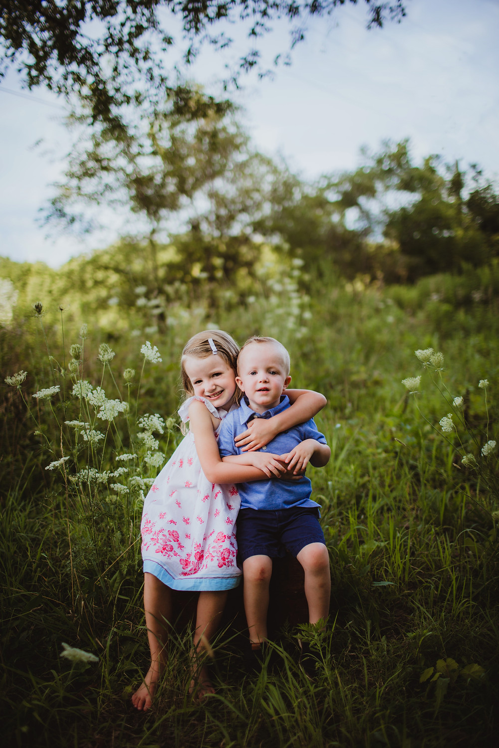 brother and sister pose in wildflower field during Indianapolis Family Photos