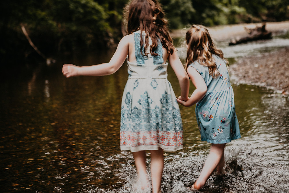 Girls creek stomp during family photos in Indiana by HashTag Memories