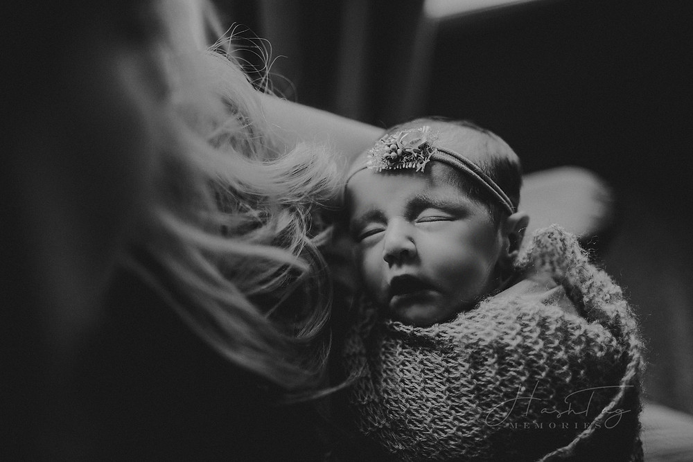 black and white newborn photography, baby girl held by mom in Indianapolis, IN
