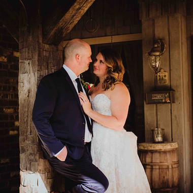 Bride & Groom At Rustic Wedding Venue