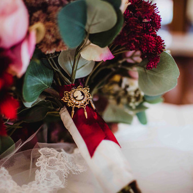 fall bridal boquet of pinks and reds