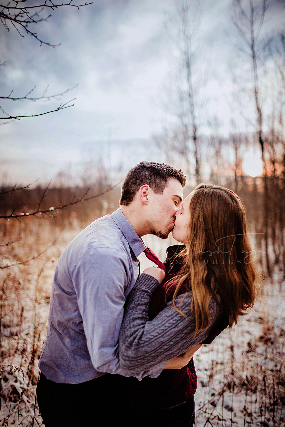 couple kisses during engagement session in noblesville from indiana wedding photographer