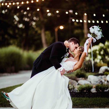 Bride & Groom Kiss Under Twinkle Lights