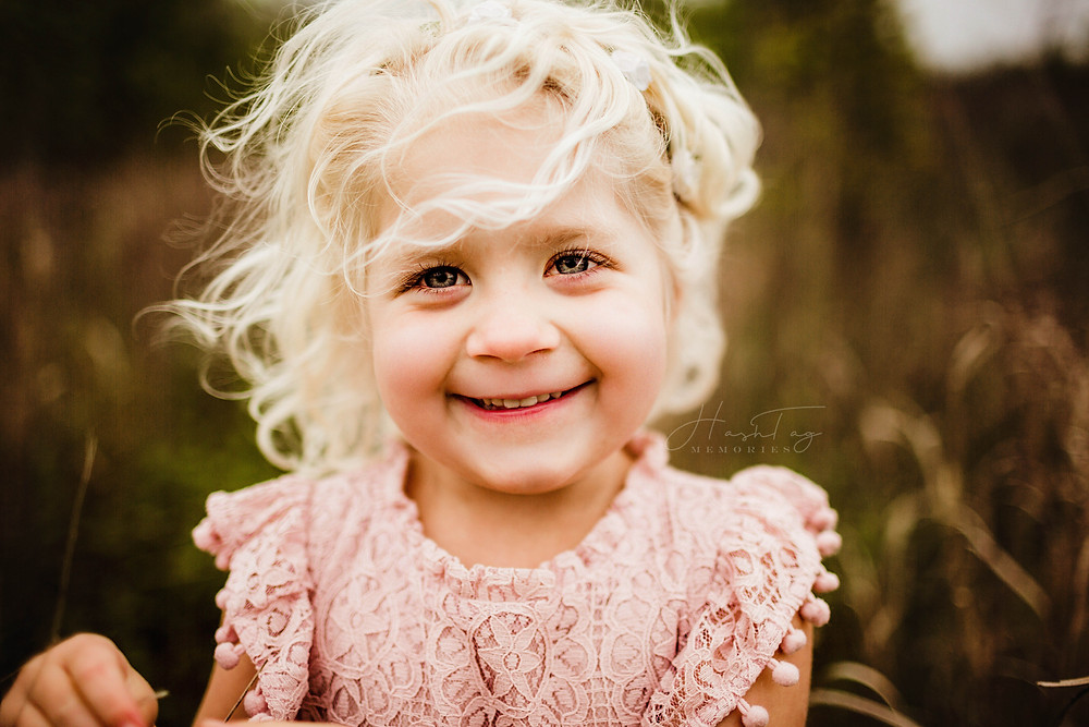 pink target dress on toddler with blond curls during family photo session in Indianapolis, In