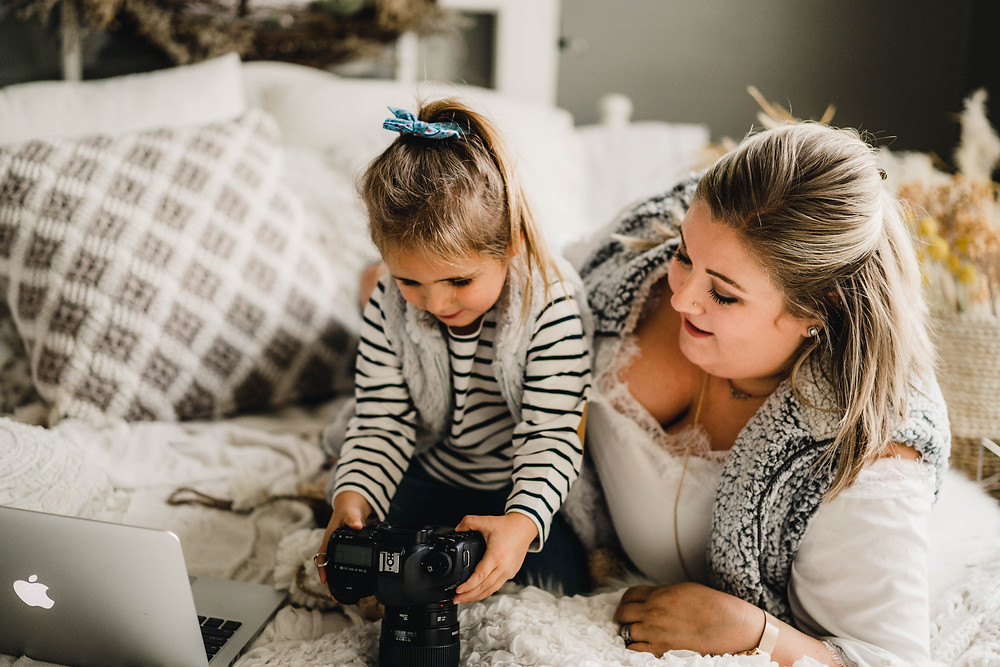 mom and daughter look at camera, indy wedding photographer, noblesville newborn baby photography