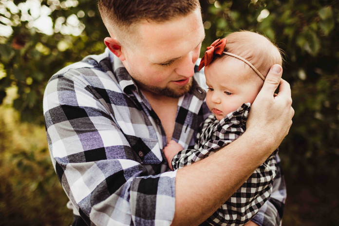 daddy holding baby girl during family photo sessions in noblesville by central indiana photographer