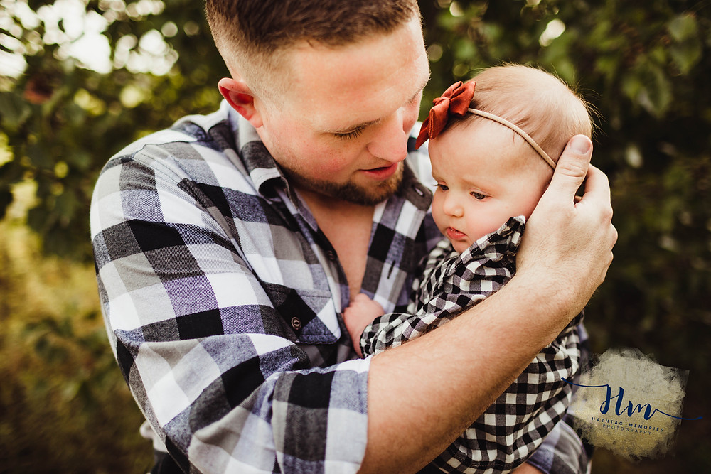 black and white buffalo checker shirts, daddy and daughter, fall baby bows, daddy snuggles, Indy Family Photographer