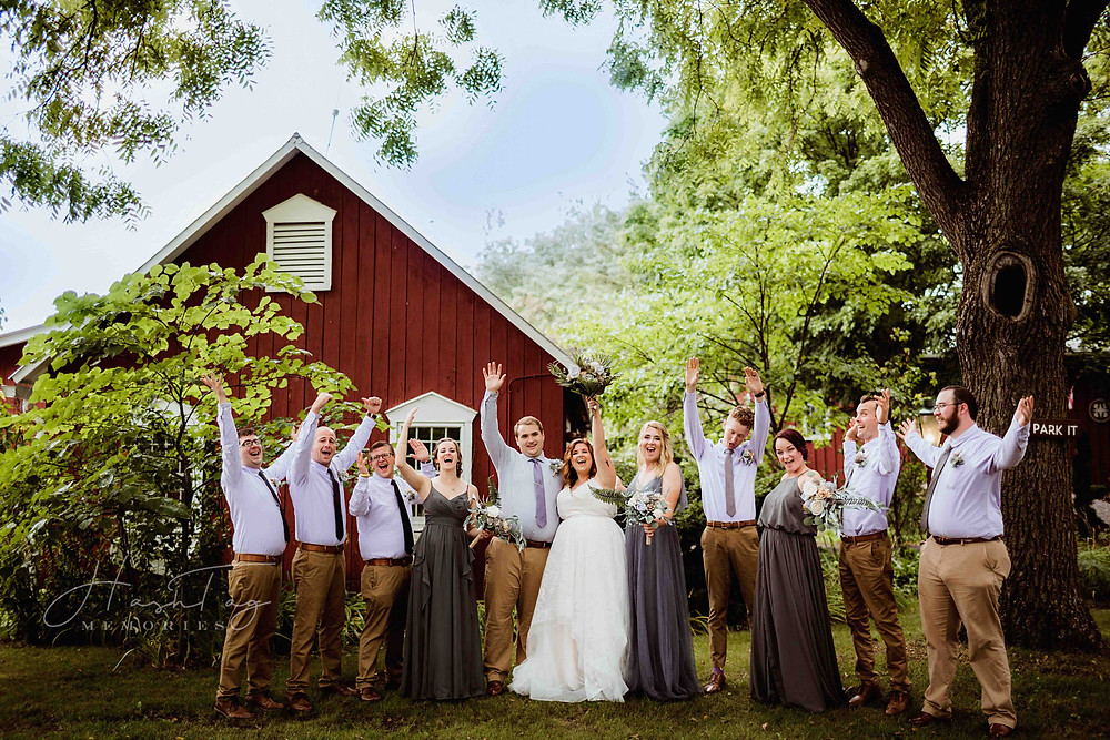 fort wayne wedding party celebrating at red barn acers wedding venue, central indiana bride by noblesville wedding photographer