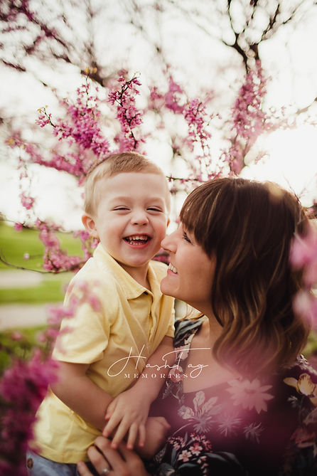 spring family photo session with mother and son in flowers by carmel, indiana photographer
