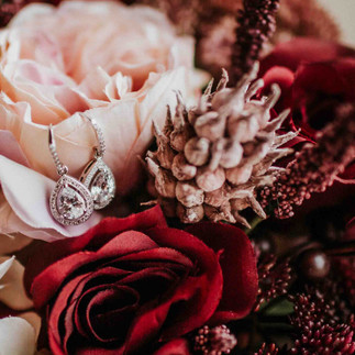 brides earings in pink and red wedding bouquet