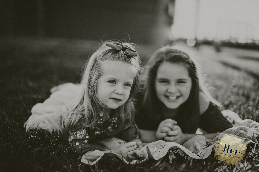 Indy sisters play during family photos by HashTag Memories