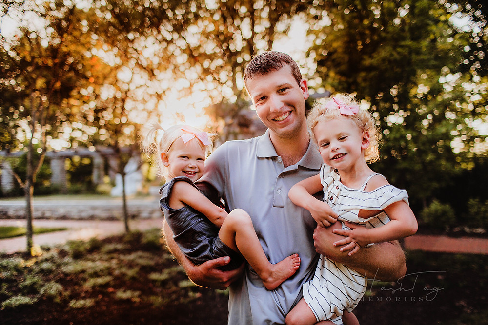 toddler girls snuggle daddy in indianapolis family photos at allison mansion