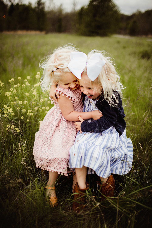 sister poses hugging, hashtag memories photography
