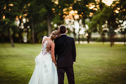bride in tatto lace ballgown and groom at the loft on isanogle central indiana wedding venue
