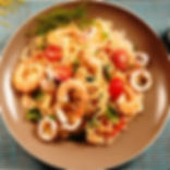 Awesome Italian seafood spaghetti with prawns and calamari in tomato sauce and basil