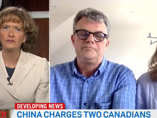 China Charges Two Canadians