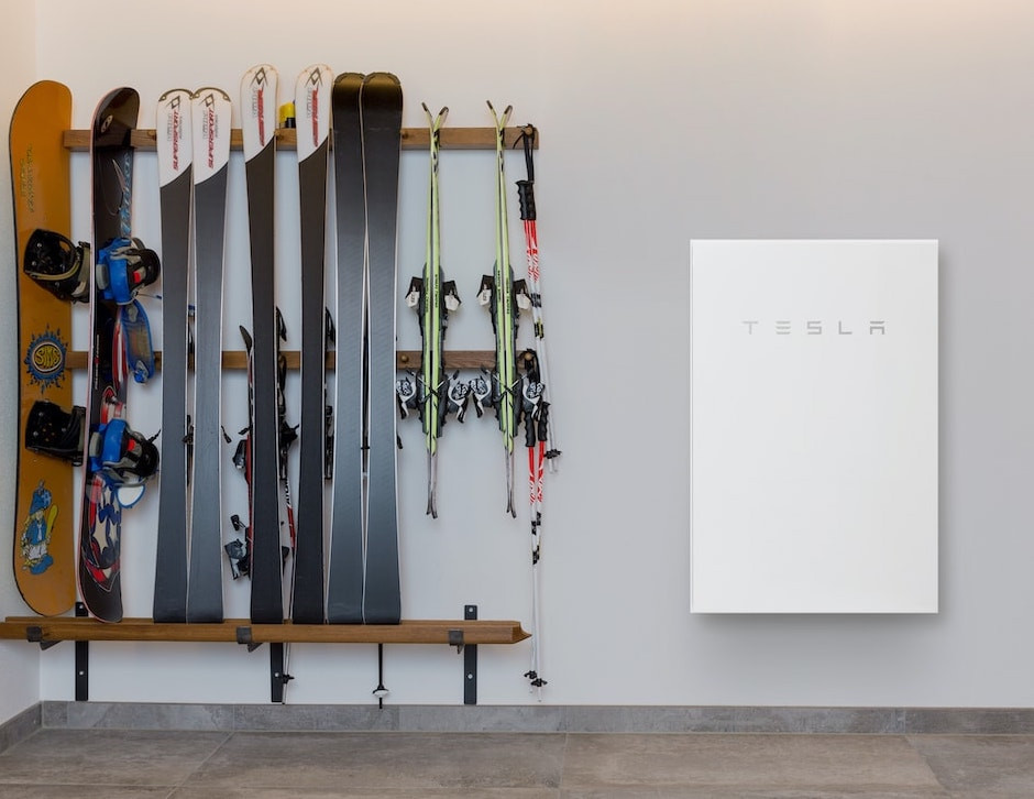 Tesla powerwall solar powered battery next to ski rack