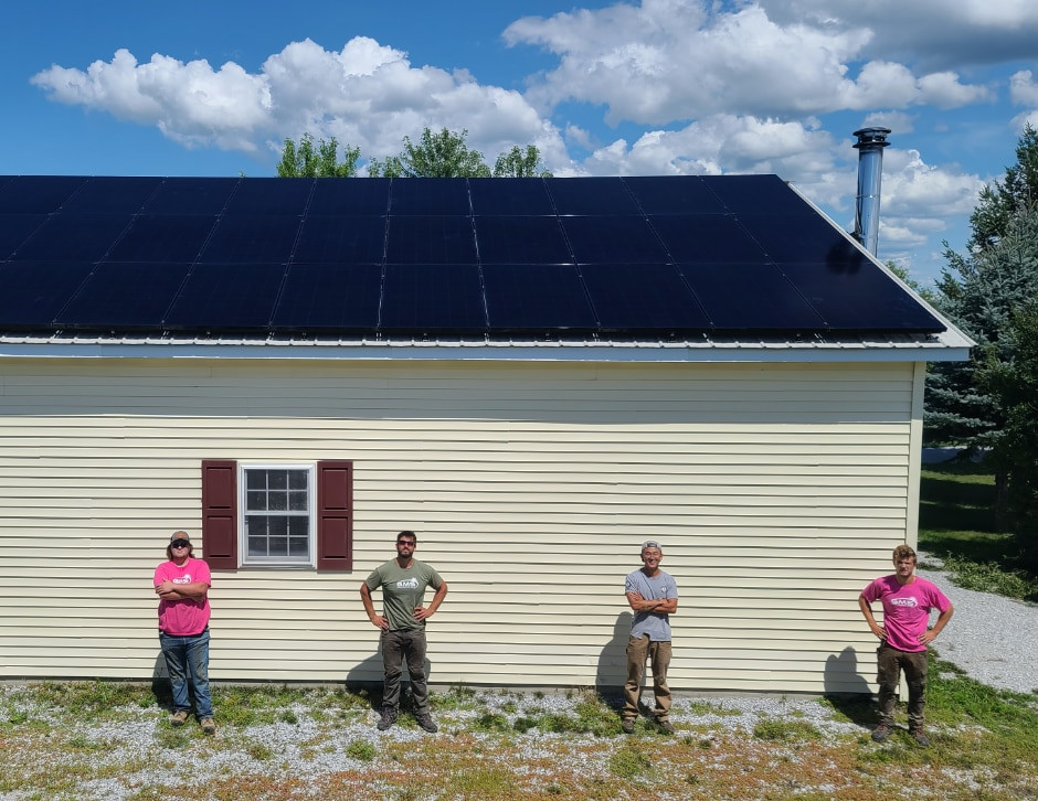 solar installers in front of roof mounted solar panels