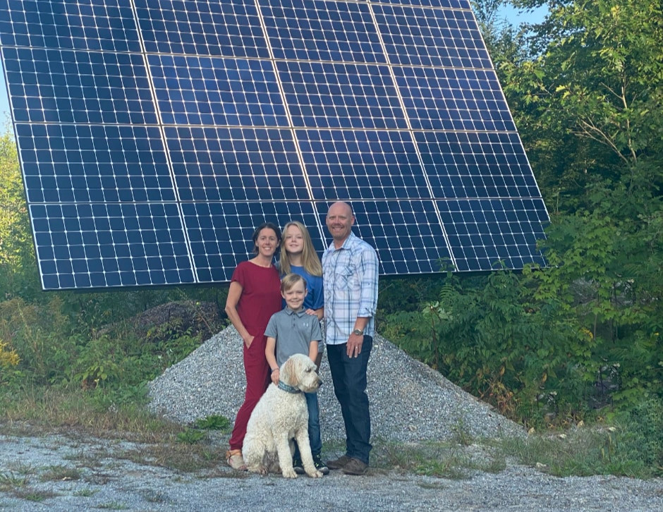 Family in New Hampshire with solar panels and dog