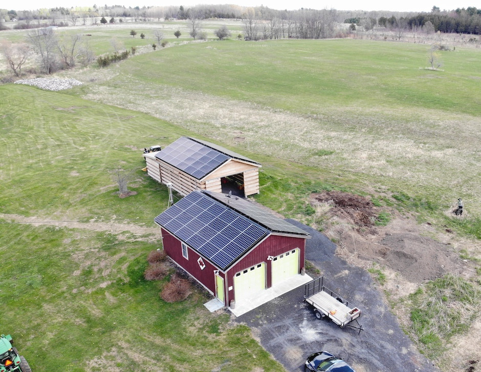 drone photo of solar panels on a barn and shed in vermont