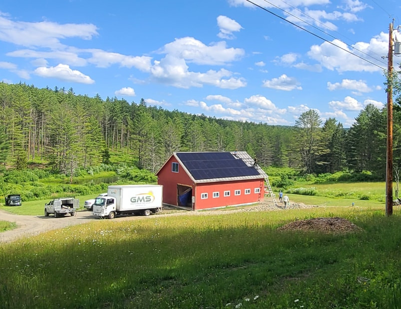red barn in vermont with solar panels