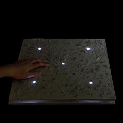 Piezoelectric pavement slab lit
