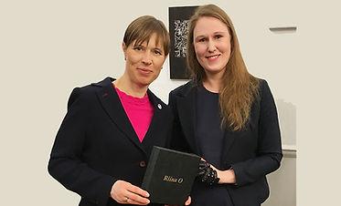 Riina with president final web3.jpg
