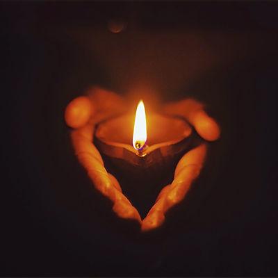 person holding lighted oil lamp_edited.jpg
