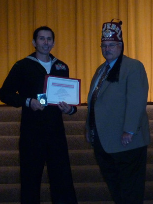 Petty Officer 1st Class Snake Blocker receiving Shriner's Medal of Honor Medal & Certificate for 6th Annual Uniform Service Recognition   Nominated/Awarded 2012 El Jebel Shrinners, Denver, Colorado