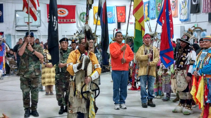 Native Veterans: Snake Blocker next to Brad Bearsheart (Champion Native Dancer) presenting as Native American Honor Guards for the Denver Indian Center New Years Pow Wow