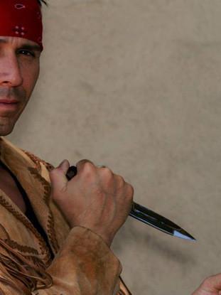 Snake Blocker holding two custom knives: The Snake Knife & The Venom Knife (JW Smith & Sons Custom Knives)