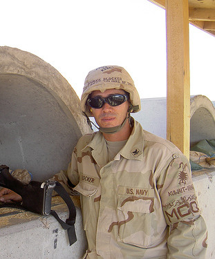 Petty Officer Snake Blocker shooting the M249 Squad Automatic Weapon (SAW), Kuwait 2004