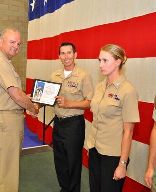 Petty Officer 1st Class Snake Blocker receiving Sailor of the Quarter Award