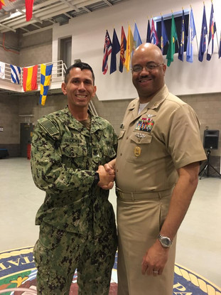 Petty Officer 1st Class Snake Blocker with Navy Reserve Force Master Chief C.J. Mitchell