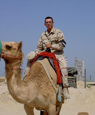 Petty Officer Snake Blocker riding a Camel, Kuwait Tour 2004