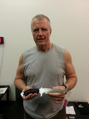 W. Hock Hochheim holding Apache Falcon Trainer Knife by Snake Blocker