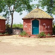 Kaamna-Rajasthan-May2017-5 circ huts.jpg