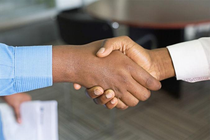 two person handshaking_edited.jpg