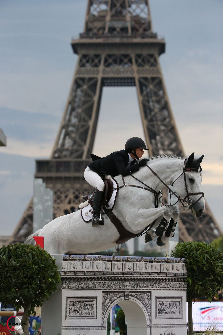 Georgina Bloomberg and Juvina, right in front of the #Eiffel Tower! - #Longines Global Champions Tour Paris Eiffel Jumping presented by #Gucci © Sportfot