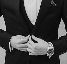 man in suite with luxury watch