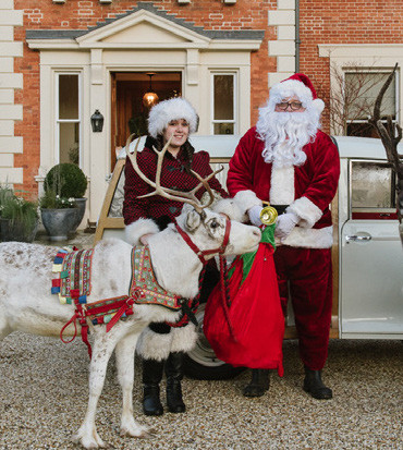 Father Christmas outside Heckfield Place