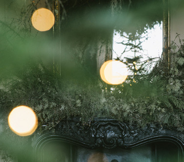 Christmas foliage around a fireplace