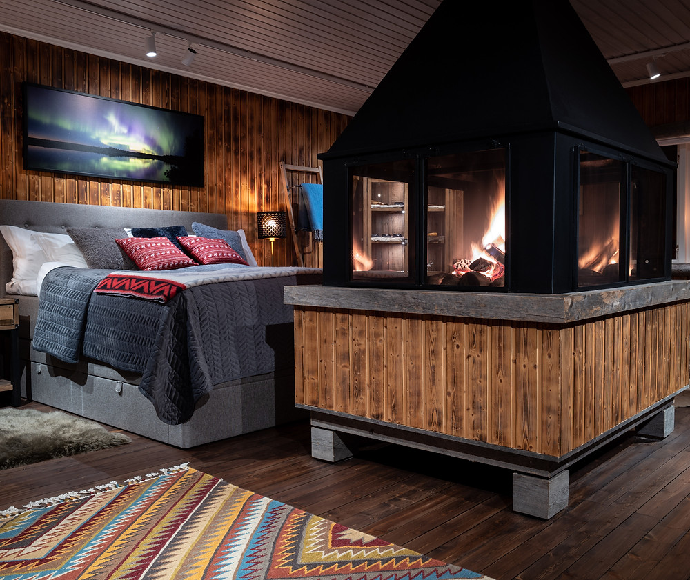 Bedroom with a fire place at Logger's Lodge
